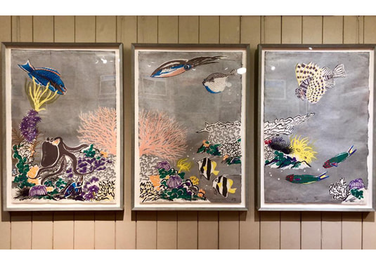 Photo of three pieces of artwork at the Isaacs Art Center in Big Island (provided by Diana Mahaney)