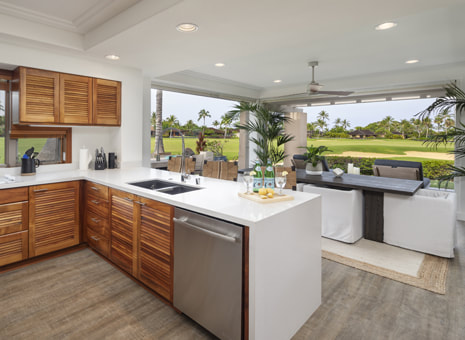 Luxury rental of kitchen and living room opened to outside and golf course views, provided by Big Island Realtor Diana Mahaney
